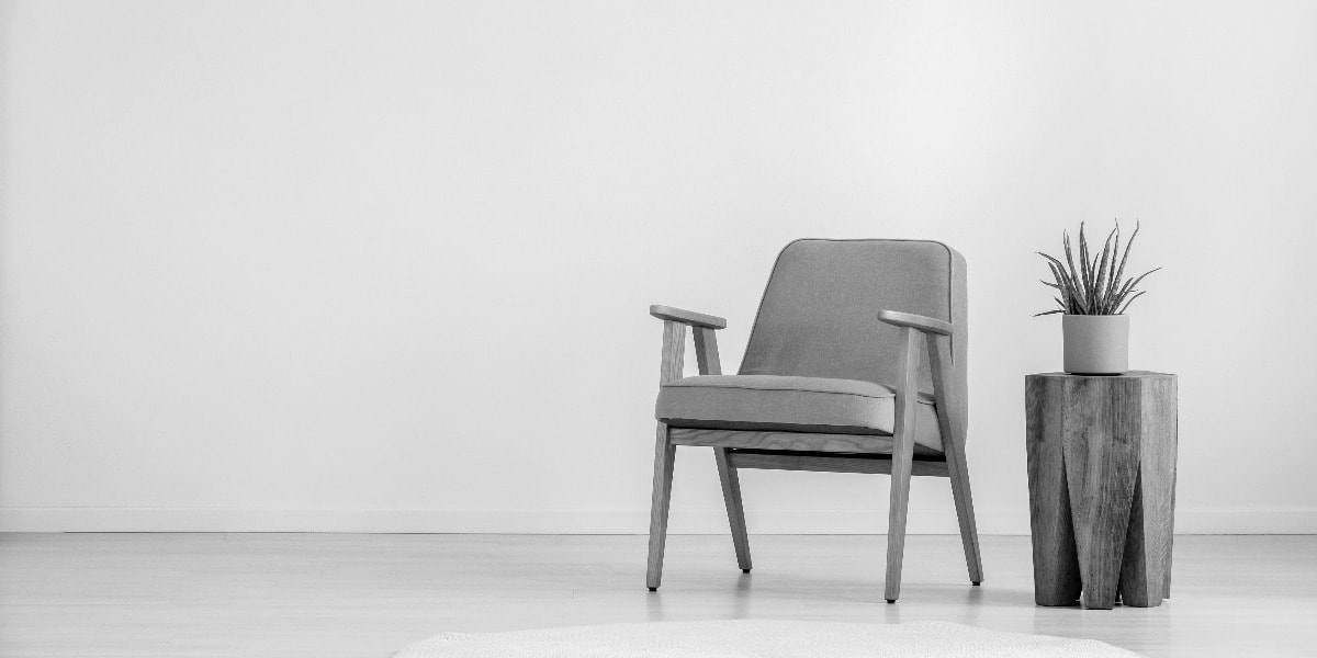 white space chair in empty room