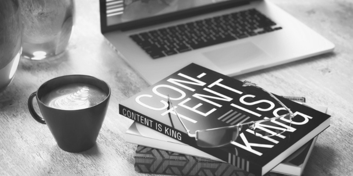 content is king coffee and books with computer